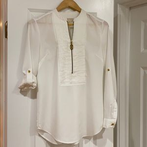 MK blouse with zipper and rolled up sleeves.